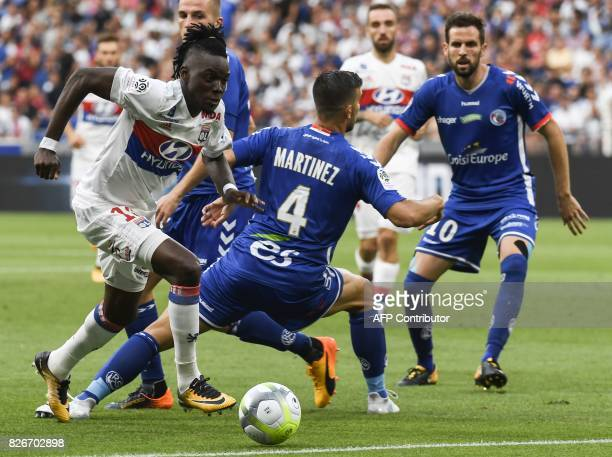 Lyon's Burkinabese forward Andre Traore vies with Strasbourg's French midfielder Pablo Martinez and French midfielder Benjamin Corgnet during the...