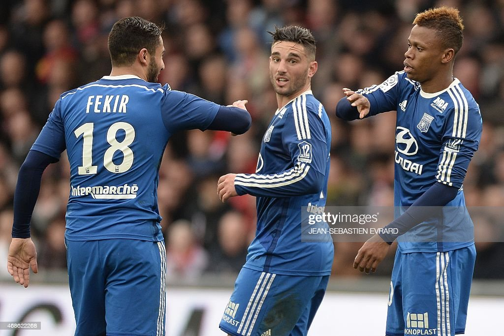 Lyon's Cameroonian forward Clinton Njie (R) celebrates with Lyon's French midfielder Jordan Ferri (C) and Lyon's French midfielder Nabil Fekir (L) after scoring a goal during the French L1 football match between Guingamp and Lyon on April 4, 2015 at the Roudourou stadium in Guingamp, western of France.