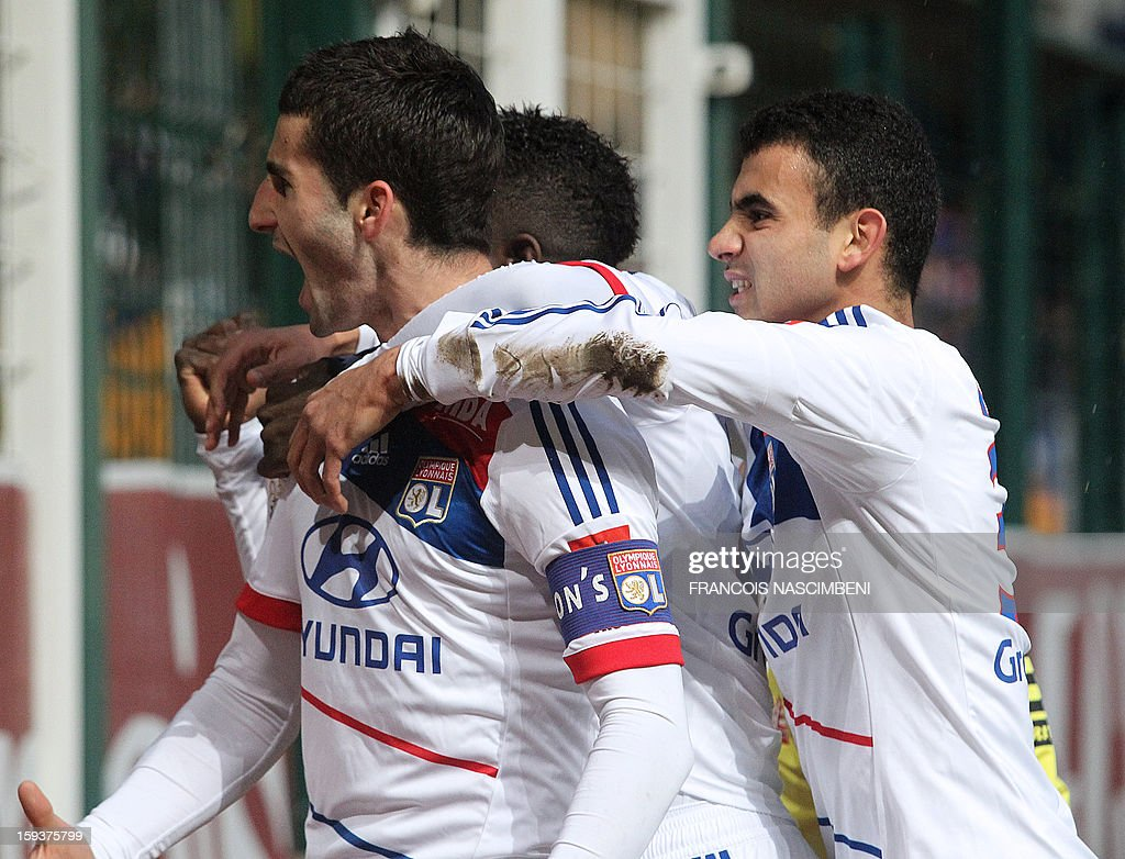 Lyon's captain Maxime Gonalons (L) is congratulated by teammates after scoring during the French L1 football match Troyes vs Lyon on January 12, 2013 at the Aube Stadium in Troyes, northern France. PHOTO FRANCOIS NASCIMBENI