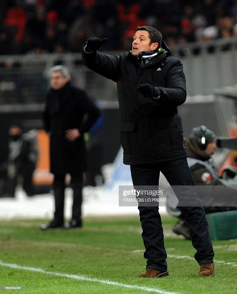 Lyon's coach Remi Garde gestures during the French L1 football match Valenciennes vs Olympique lyonnais at the stadium 'stade du hainaut' in Valenciennes on January 25, 2013. AFP PHOTO FRANCOIS LO PRESTI
