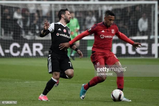 Lyon's Corentin Tolisso vies with Besiktas' Gokhan Gonul during the UEFA Europa League second leg quarter final football match between Besiktas and...