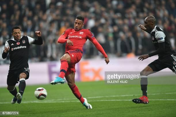 Lyon's Corentin Tolisso vies with Besiktras's Atiba Hutchinson and Adriano during the UEFA Europa League second leg quarter final football match...