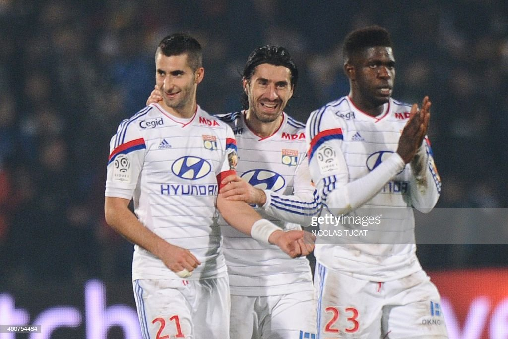 Lyon's defender <a gi-track='captionPersonalityLinkClicked' href=/galleries/search?phrase=Maxime+Gonalons&family=editorial&specificpeople=6256905 ng-click='$event.stopPropagation()'>Maxime Gonalons</a>, <a gi-track='captionPersonalityLinkClicked' href=/galleries/search?phrase=Milan+Bisevac&family=editorial&specificpeople=600075 ng-click='$event.stopPropagation()'>Milan Bisevac</a>, and Samuel Umtiti (From LtoR) celebrate after a team mate scored a goal during the French L1 football match between Girondins de Bordeaux (FCGB) and Lyon (OL) on December 21, 2014 at the Chaban-Delmas stadium in Bordeaux, southwestern France.