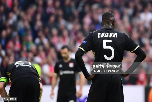 Lyon's defender Mouctar Diakhaby reacts during UEFA Europa League semifinal first leg Ajax Amsterdam v Olympique Lyonnais on May 3 2017 in Amsterdam...