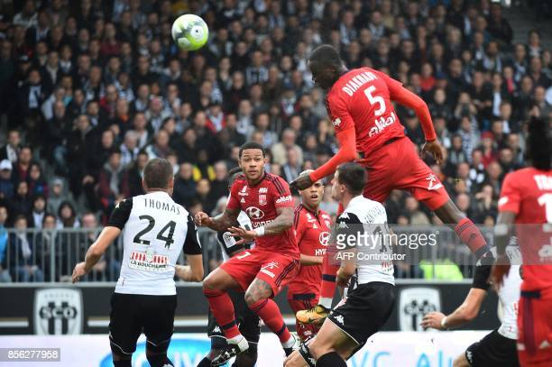 Lyon's defender Mouctar Diakhaby scores a goal during the French L1 football match between Angers and Lyon on October 1 2017 at the RaymondKopa...