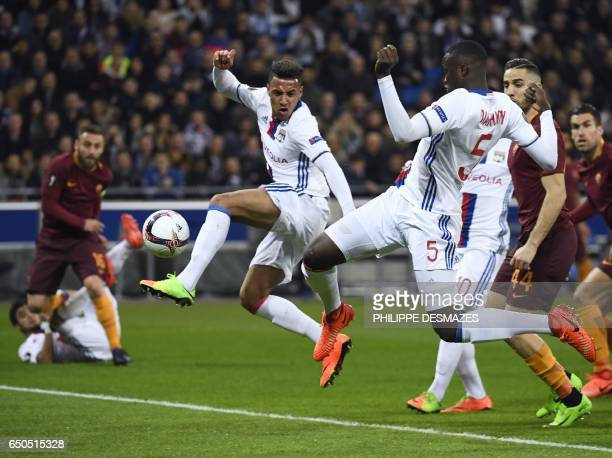 Lyon's defender Mouctar Diakhaby shoots and scores duringo the Europa League round of 16 first leg football match between Lyon and AS Roma on March 9...