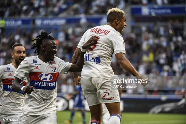 Lyon's Dominican Republic forward Mariano Diaz is congratuled by teamate Lyon's Burkinabese midfielder Andre Traore and Lyon's Spanish midfielder...