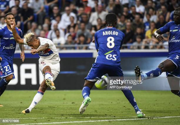 Lyon's Dominican Republic forward Mariano Diaz shoots and scores against Strasbourg's Ivorian defender Jean Aholou and Strasbourg's Senegalese...
