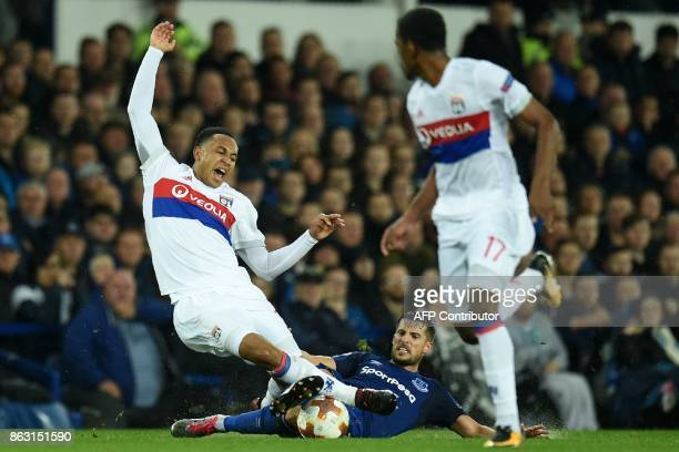Lyon's Dutch defender Kenny Tete is tackled by Everton's Belgian striker Kevin Mirallas during the UEFA Europa League Group E match between Everton...