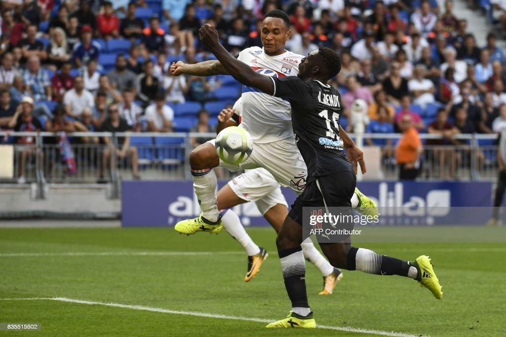Lyon's Dutch defender Kenny Tete (L) shoots and scores during the L1 football match Olympique Lyonnais (OL) vs FC Girondins de Bordeaux (FCGB), on August 19, 2017 at the Groupama stadium in Décines-Charpieu near Lyon, southeastern France. /