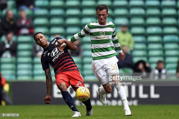 Lyon's Dutch defender Kenny Tete vies with Celtic's Scottish midfielder Liam Henderson during the preseason friendly football match between Glasgow...