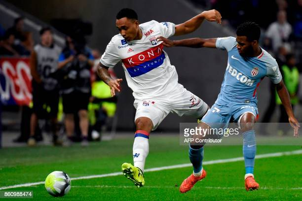 Lyon's Dutch defender Kenny Tete vies with Monaco's Belgian midfielder Youri Tielemans during the French L1 football match between Lyon and Monaco on...
