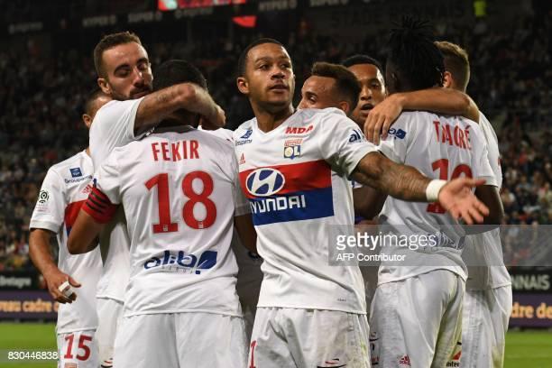 Lyon's Dutch forward Memphis Depay as Lyon's team celebrates scoring a goal during the French L1 football match between Stade Rennais and Olympique...