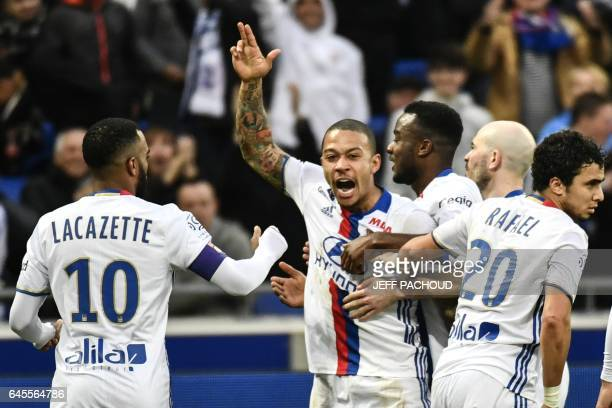 Lyon's Dutch forward Memphis Depay celebrates after scoring a goal during the French L1 football match Olympique Lyonnais vs FC Metz at Parc...