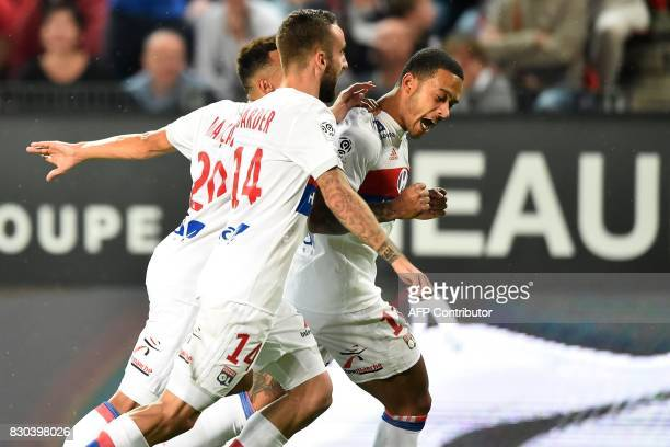 Lyon's Dutch forward Memphis Depay celebrates with his teammate Lyon's Spanish midfielder Sergi Darder after scoring during the French L1 football...