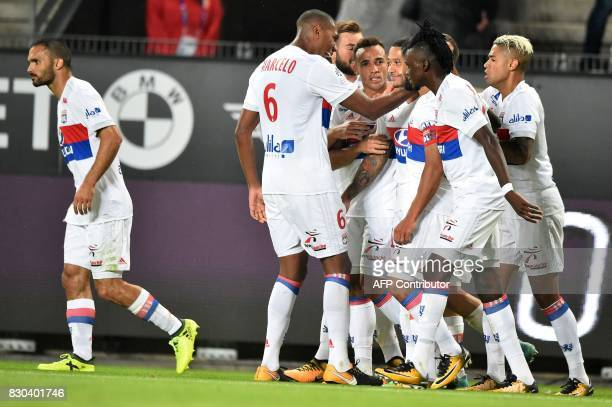 Lyon's Dutch forward Memphis Depay celebrates with his teammates after scoring during the French L1 football match between Rennes and Lyon on August...