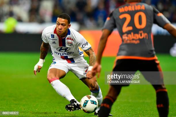 Lyon's Dutch forward Memphis Depay controls the ball during the French L1 football match between Olympique Lyonnais and Lorient on April 8 at the...