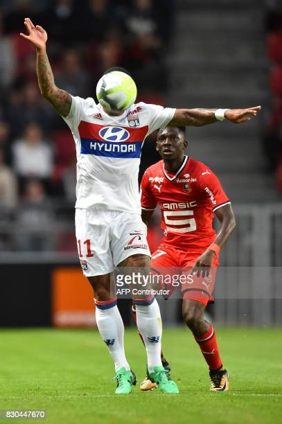 Lyon's Dutch forward Memphis Depay controls the ball with the head during the French L1 football match between Rennes and Lyon on August 11 at the...