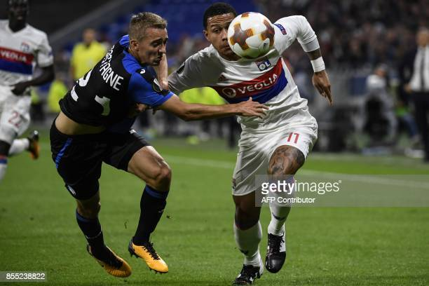 Lyon's Dutch forward Memphis Depay fights for the ball against Atalanta's Belgium defender Timothy Castagne during the Europa League football match...