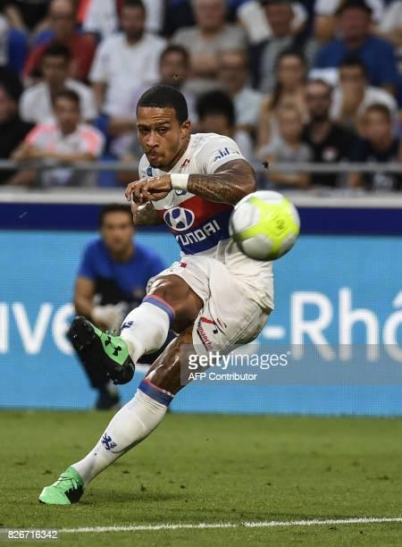 Lyon's Dutch forward Memphis Depay kicks the ball during the Ligue1 football match Olympique Lyonnais against Racing Club de Strasbourg Alsace on...