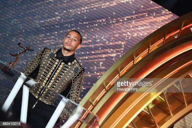 Lyon's Dutch forward Memphis Depay reacts after receiving the award of the Goal of the Year during the 26st edition of the UNFP trophies ceremony at...