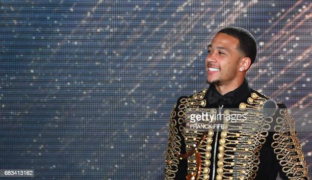 Lyon's Dutch forward Memphis Depay reacts after receiving the award of the Goal of the Year during the 26th edition of the UNFP trophies ceremony at...