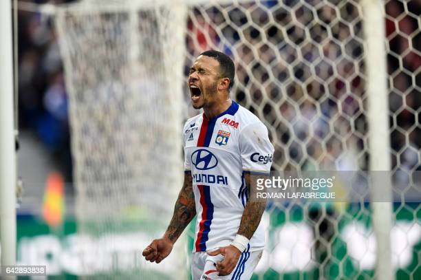Lyon's Dutch forward Memphis Depay reacts during the French L1 football match between Olympique Lyonnais and Dijon on February 19 at the Parc...