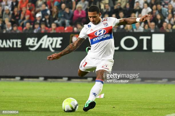 Lyon's Dutch forward Memphis Depay shoots and scores during the French L1 football match between Rennes and Lyon on August 11 at the Roazhon Park...