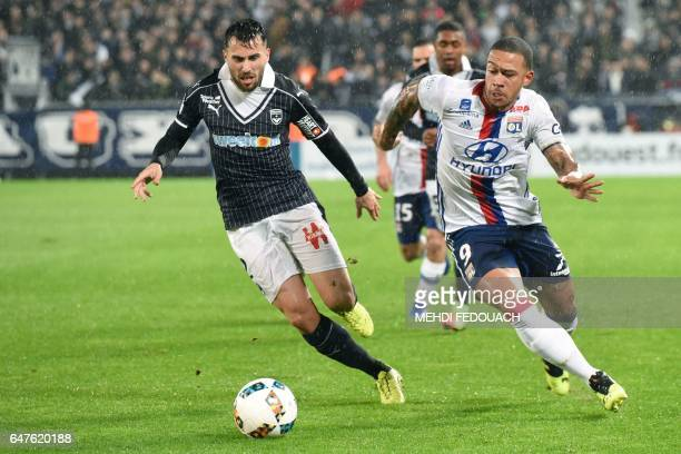 Lyon's Dutch forward Memphis Depay vies for the ball with Bordeaux's Serbian defender Milan Gajic during the French L1 footbal match between Bordeaux...