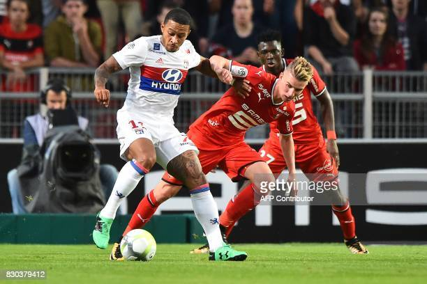 Lyon's Dutch forward Memphis Depay vies for the ball with Rennes' French midfielder Benjamin Bouigeaud during the French L1 football match between...