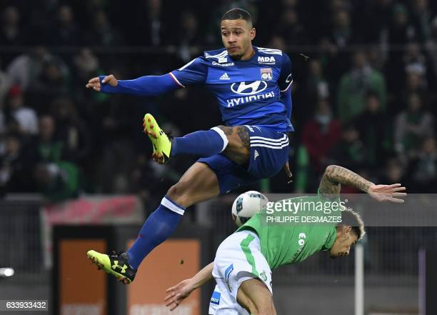 Lyon's Dutch forward Memphis Depay vies with SaintEtienne's French defender Kevin Malcuit during the French L1 football match between AS SaintEtienne...