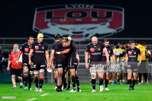Lyons Fiji wing Napolioni Nalaga celebrates with Lyons English fullback Delon Armitage during the French Top 14 rugby union match between Lyon...
