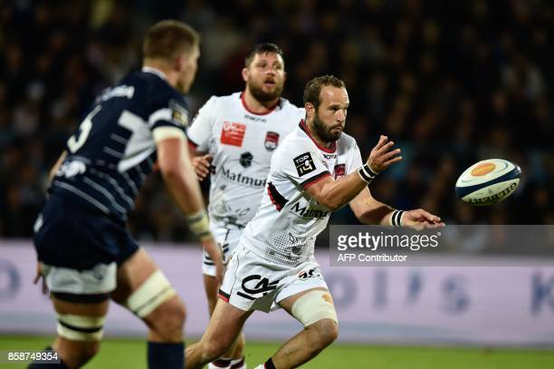 Lyon's flyhalf Frederic Michalak passes the ball during the French Top 14 rugby union match between SU Agen and Lyon at The Armandie Stadium in Agen...
