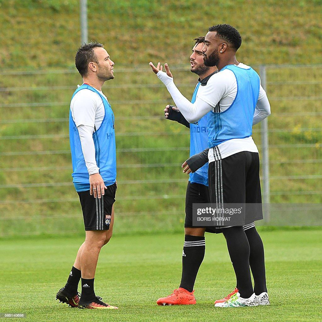 Lyon s forward Alexandre Lacazette R chats with Lyon s forward