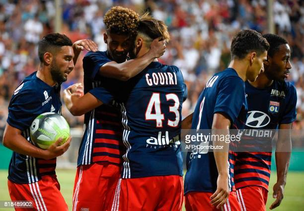 Lyon's forward Amine Gouiri celebrates with teammate Willem Geubbels after scoring a goal during a friendly football match between Olympique Lyonnais...