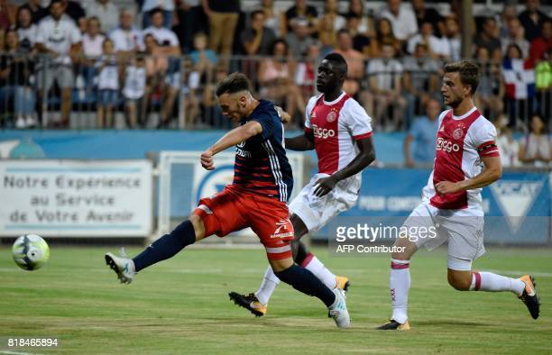 Lyon's forward Amine Gouiri vies with Ajax defender Joel Veltman during a friendly football match between Olympique Lyonnais and Ajax Amsterdam on...