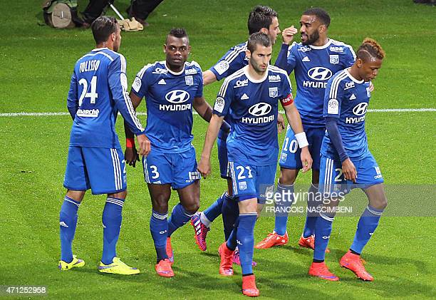 Lyon's forward Clinton Mua Njie celebrates with Lyon's players after scoring a goal during the French Football match between Reims and Lyon on April...