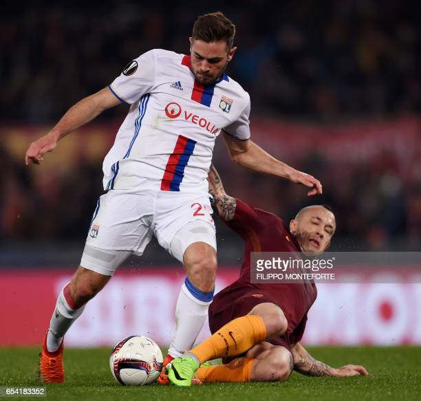 Lyon's forward from France Maxwel Cornet vies with Roma midfielder from Belgium Radja Nainggolan during the Europa League Round of 16 return football...