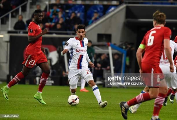 Lyon's forward Houssem Aouar controls the ball during the UEFA Europa League football match between Olympique Lyonnais and AZ Alkmaar on February 23...
