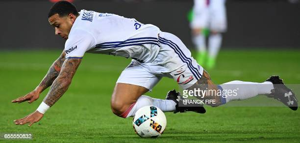 Lyon's forward Menphies Depay falls down during the French L1 football match between Paris SaintGermain and Olympique Lyonnais at the Parc des...