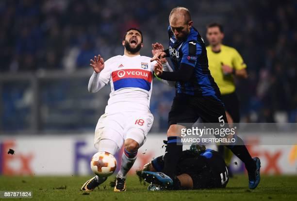 Lyon's forward Nabil Fekir vies with Atalanta's defender Andrea Masiello during the UEFA Europa League group E football match Atalanta vs Olympique...