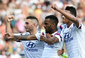 Lyon's Frecnh forward Alexandre Lacazette reacts after scoring next to Lyon's French midfielder Jordan Ferri and Lyon's French midfielder Corentin...