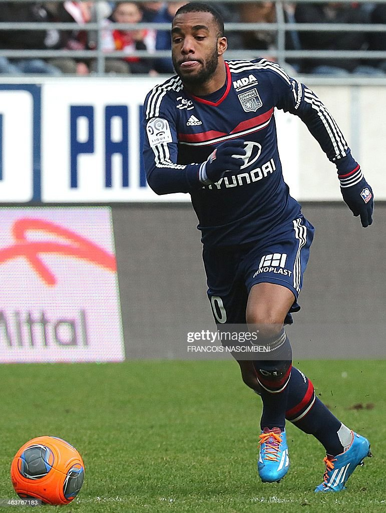 Lyon's Frecnh forward Alexandre Lacazette runs with the ball during a French L1 Football match between Reims and Lyon on January 19, 2014 at the Auguste Delaune Stadium in Reims.