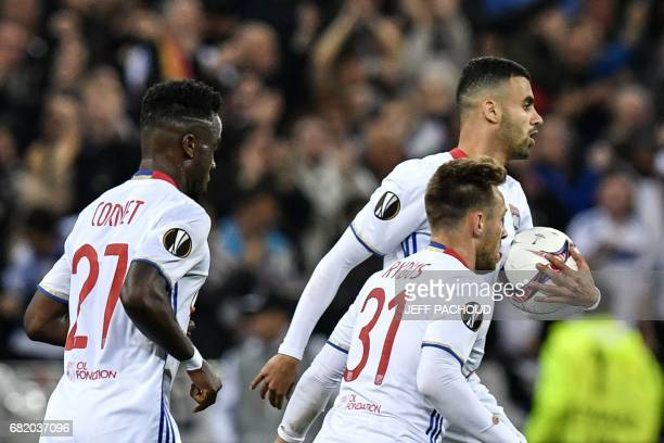 Lyon's French Algerian midfielder Rachid Ghezzal celebrates after scoring a goal during the UEFA Europa League semifinal football match between...
