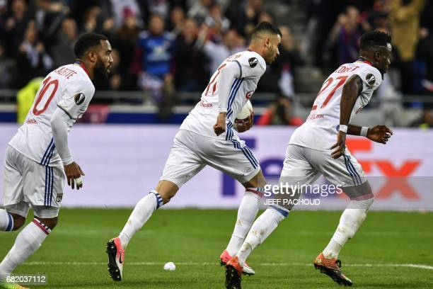 Lyon's French Algerian midfielder Rachid Ghezzal celebrates after scoring a goal during the Europa League semi final football match Olympique...