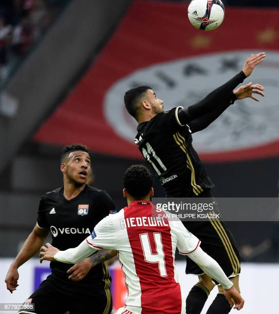 Lyon's French Algerian midfielder Rachid Ghezzal heads the ball during UEFA Europa League semifinal first leg Ajax Amsterdam v Olympique Lyonnais on...
