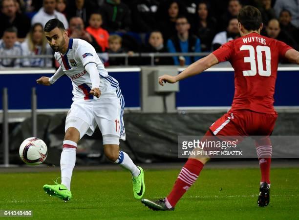 Lyon's French Algerian midfielder Rachid Ghezzal kicks the ball past Alkmaar's Belgian midfielder Stijn Wuytens during the UEFA Europa League...