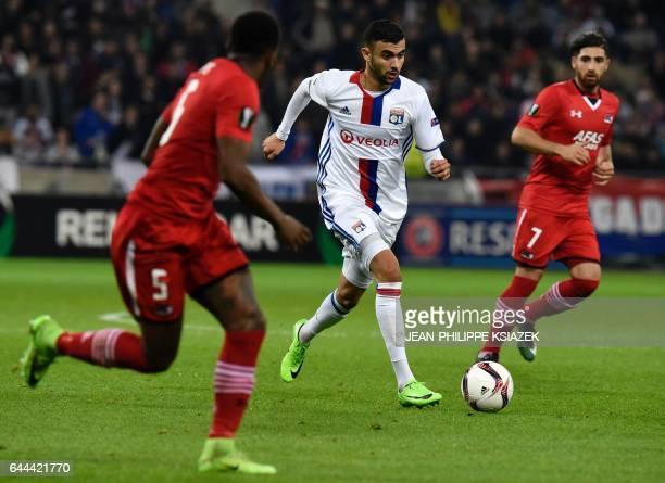 Lyon's French Algerian midfielder Rachid Ghezzal outruns Alkmaar's Dutch midfielder Ridgeciano Haps during the UEFA Europa League football match...