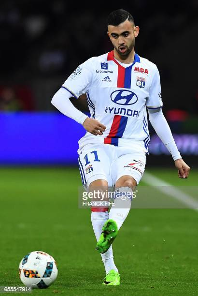 Lyon's French Algerian midfielder Rachid Ghezzal passes the ball during the French L1 football match between Paris SaintGermain and Olympique...