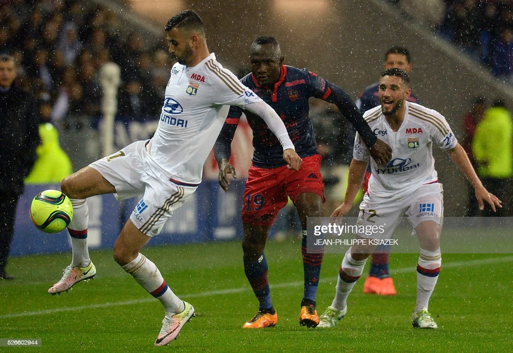 Lyon's French Algerian midfielder Rachid Ghezzal (L) vies with Ajaccio's Cameroonian forward Jacques Zoua (R) during the French L1 football match Lyon (OL) vs Ajaccio (GFCA) at the Parc Olympique Lyonnais stadium in Decines-Charpieu, central eastern France, on April 30, 2016.